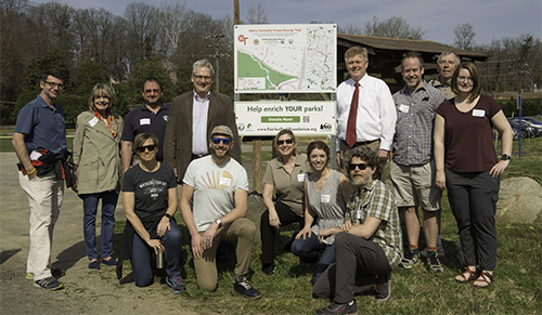 REI group with sign.