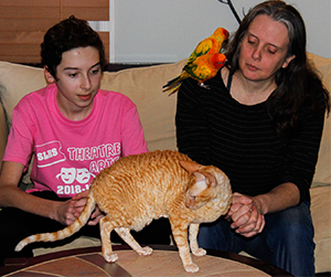 Lazar mother and son with a cat and a bird.