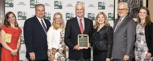 Mr. Thormahlen holding VRPS Volunteer Award plaque.