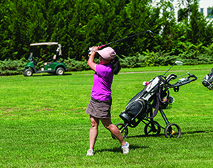 Woman golfing.